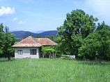 12,200 sq.m. land,  130 sq.m. house in the mountains, 90 km to Sofia, near golf course